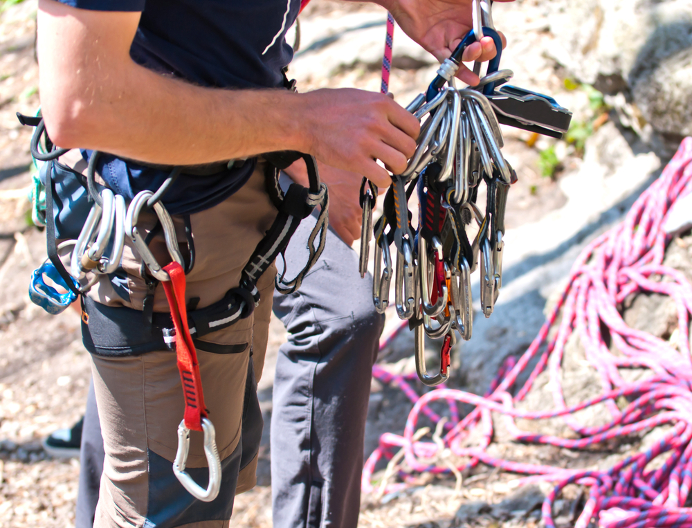 Guy with equipment before climb - shutterstock_85753573
